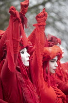 28-02-2020 - The Invisible Circus, Extinction Rebellion activists dressed in red robes and with white makeup, Bristol Youth Strike 4 Climate protest © Paul Box