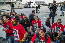 14-02-2020 - San Francisco International Airport, USA, UNITE HERE service workers protest low pay and the failure of employers to agree a fair contract. The workers, who prepare food for airlines, die-in, laying d... © David Bacon