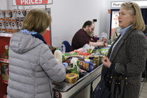 19-03-2020 - Shopworkers serving customers, Sainsburys supermarket, Putney, London © Duncan Phillips