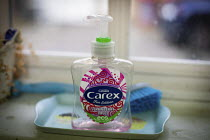 20-03-2020 - Empty antibacterial hand wash, Carex Fun Edition Strawberry Laces hand gel 50ml, Eco bottle, Kilburn, London © Connor Matheson