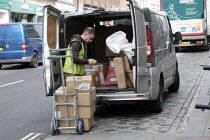 20-03-2020 - Driver making a delivery. Delivery drivers are amongst those workers deemed essential to the coronavirus response, Richmond, London © Duncan Phillips