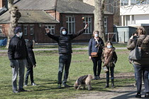 22-03-2020 - Family wearing facemasks posing for a photograph, park, Barnes, London © Duncan Phillips