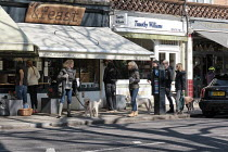 22-03-2020 - Dog walkers failing to observe social distancing whilst queuing, Barnes Village, London © Duncan Phillips
