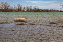 22-03-2020 - Detroit, Michigan USA. Picnic table far from land, Belle Isle state park. Record high water levels on Detroit River and the Great Lakes have led to shoreline erosion and flooding. © Jim West