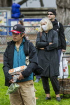27-03-2020 - Berkeley, California, USA, Coronavirus pandemic, customers queuing, farmers market © David Bacon