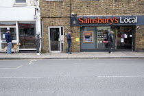 30-03-2020 - Coronavirus pandemic, Queuing and social distancing, Sainsbury's local, Barnes, London © Duncan Phillips