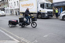 30-03-2020 - Coronavirus pandemic, electric bike delivery service set up by local independent shops to deliver food and vital supplies, Barnes, London © Duncan Phillips