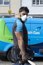 31-03-2020 - Coronavirus pandemic, British Gas Engineer with face mask, home heating repair, Stratford Upon Avon, Warwickshire © John Harris
