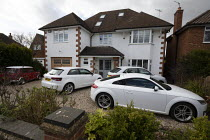03-04-2020 - Coronavirus pandemic, Cars parked in the driveway as people stay at home, Stratford Upon Avon, Warwickshire © John Harris