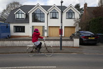 04-04-2020 - Coronavirus Pandemic. Elderly cyclist covering face, Stratford Upon Avon, Warwickshire © John Harris