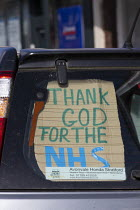 06-04-2020 - Coronavirus Pandemic. Thank God For the NHS sign in the back of a car, Stratford Upon Avon, Warwickshire © John Harris
