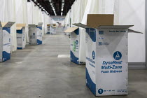 06-04-2020 - Detroit, Michigan USA. Emergency field hospital under construction, TCF convention center. The 1,000-bed hospital will care for Covid-19 patients Mattress boxes line the hall outside patient cubicles. © Jim West