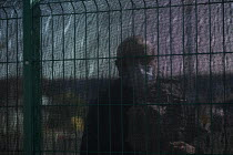 07-04-2020 - Coronavirus Pandemic. Police officer questioning journalist through a fence. Testing NHS workers for Covid-19, Drive thru Coronavirus test centre, Edgbaston Cricket Ground car park, Birmingham. © John Harris
