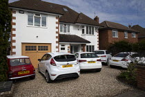 08-04-2020 - Coronavirus pandemic, Cars parked in the driveway as people stay at home, Stratford Upon Avon, Warwickshire © John Harris
