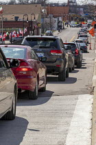 08-04-2020 - Detroit, Michigan USA. Coronavirus Pandemic, long line of cars queuing at Gleaners Community Food Bank which is distributing free food to locals in need © Jim West