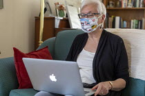 08-04-2020 - Detroit, Michigan USA. Coronavirus Pandemic. Susan Newell 71 wearing a homemake face mask whilst taking part of a Zoom meeting online © Jim West