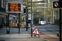 11-04-2020 - Coronavirus pandemic. Road sign warning Essential Travel Only Stay At Home Save Lives, deserted streets, Bristol © Sam Morgan Moore