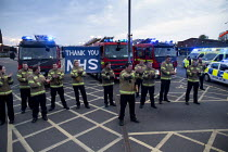 16-04-2020 - Firefighters Clap for Our Carers University Hospital Coventry. Thank you NHS banner and fire engines © John Harris