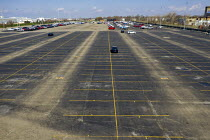 18-04-2020 - Detroit, Michigan USA Coronavirus Pandemic New Car Inventory Reduced, Fiat Chrysler factory. The nearly empty parking lot where trucks and cars built by normally await transport to dealers. The yard i... © Jim West