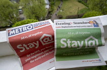 18-04-2020 - Coronavirus pandemic. Stay at Home Metro and Evening Standard front pages, free newspapers delivered to London households, Tower Hamlets, East London © Jess Hurd