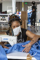 27-04-2020 - Detroit, Michigan, USA. Workers making protective gowns for health workers, Industrial Sewing and Innovation Center (ISAIC) a newly opened sewn goods manufacturing and training nonprofit. It was set t... © Jim West