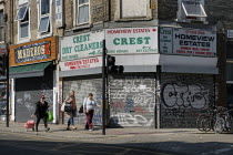 04-22-2020 - Coronavirus pandemic. Shoppers walking past closed shops and businesses, Kilburn, London © Philip Wolmuth