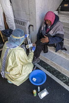 01-05-2020 - Detroit, Michigan USA. Coronavirus Pandemic. Homeless people getting medical help, Pope Francis Center. The Center has had to close its indoor spaces due to the coronavirus pandemic. Dr. Asha Shajahan... © Jim West