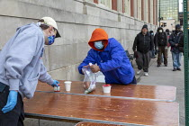 01-05-2020 - Detroit, Michigan USA. Coronavirus Pandemic. Homeless getting hot meals and other help, Pope Francis Center. The Center has had to close its indoor spaces due to the. It is now serving meals on the st... © Jim West