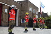 04-05-2020 - Firefighters holding a minute's silence at noon to remember fallen firefighters, Firefighters Memorial Day, Stratford Upon Avon Fire Station, Warwickshire © John Harris
