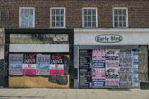 05-02-2020 - Covid-19 pandemic. Pre-lockdown flyposted adverts for now cancelled music gigs and festivals. Closed shops and businesses in Chalk Farm, London, during the coronavirus lockdown. © Philip Wolmuth