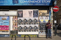 12-05-2020 - Coronavirus Pandemic. Tax Avoidance Kills posters, Brick Lane, East London © Jess Hurd