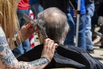 20-05-2020 - Lansing, Michigan US Coronavirus Pandemic. Barbers giving free haircuts on the lawn of the Michigan State Capitol in protest against emergency orders which keep many businesses closed. The protest, ca... © Jim West