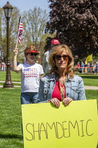 20-05-2020 - Lansing, Michigan USA. Coronavirus Pandemic rally on the lawn of the Michigan State Capitol in protest at emergency orders which keep many businesses closed. The protest, called Operation Haircut, was... © Jim West