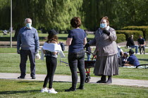14-05-2020 - Coronavirus Pandemic. Reletives meeting in the park a a safe distance, Bancroft Gardens, Stratford Upon Avon © John Harris
