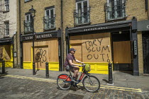 25-05-2020 - Coronavirus Pandemic Tory Scum Out graffitti on boarded up shops, London. © Jess Hurd