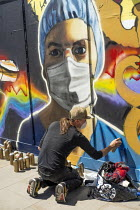 05-25-2020 - Coronavirus Pandemic: NHS heroes graffiti artist Owe1 painting a mural depicting health worker in PPE, Shoreditch, East London. © Jess Hurd