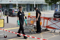 23-05-2020 - Coronavirus Pandemic: B&Q store, young shopworkers cleaning trollies, Stratford upon Avon © John Harris
