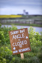 07-04-2020 - Coronavirus Pandemic. Sign asking non residents to stay away, Angle, Pembrokeshire, Wales © Paul Box