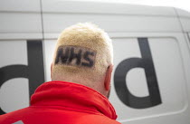 30-04-2020 - Coronavirus Pandemic. DPD delivery driver with NHS shaved into his head hair to raise funds for NHS. Pembrokeshire, Wales © Paul Box