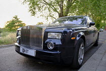 30-05-2020 - Personalised numberplate changed from IOT to IDIOT, Rolls Royce car, Putney, London. Resentment at the rich © Duncan Phillips
