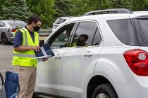 10-06-2020 - Detroit, Michigan, USA Coronavirus Pandemic. Drive through job fair for Allied Universal, a major security company. The event held in a car park allowed candidates for security officer positions to ma... © Jim West
