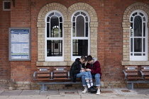 11-06-2020 - Coronavirus Pandemic. Lovers sitting on seats maked Do Not Sit Here, Stratford upon Avon Railway Station © John Harris