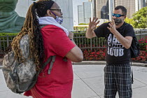 15-06-2020 - Detroit, Michigan - Deaf people talking in sign language before a Black Disabled Lives Matter protest. © Jim West