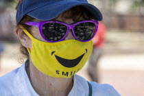 07-06-2020 - Detroit, Michigan USA Woman wearing a face mask with a smile during the coronavirus pandemic © Jim West