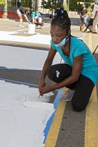 06-17-2020 - Detroit, Michigan USA POWER TO THE PEOPLE painted by youth on Woodward Avenue with the support of the city of Detroit. The project comes amid weeks of Black Lives Matter protests over the murder of Ge... © Jim West