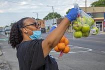 19-06-2020 - Detroit, Michigan USA Coronavirus Pandemic. Saved by Grace Christian Ministries handing out free fruit and vegetables in front of their church to the poor and the hungry © Jim West