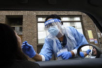 06-07-2020 - Coronavirus Pandemic. Woman being tested, drive thru testing Station, London. Mylocum Agency Nurse © Duncan Phillips