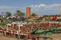 03-07-2020 - Colorado, USA, old brick grain silo and rusting farm equipment © Jim West