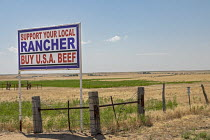 03-07-2020 - Colorado, USA. Support Your Local Rnacher Buy U.S.A. Beef sign on the roadside. © Jim West