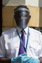 24-07-2020 - Marsk up Friday, Security guard with a face shield visor, checking visitors, District Council Offices © John Harris